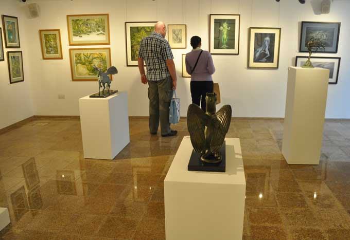 One corner of the exhibition, with works by David Wyatt, Brian Froud, Virginia Lee, and Paul Kidby, photographed by David Wyatt