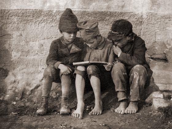 Boys Reading by André Kertész