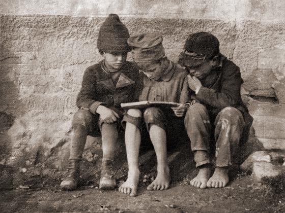Boys Reading by André Kertész