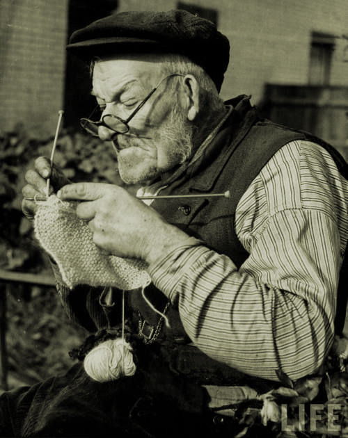 A man knits garments for servicemen during World War II