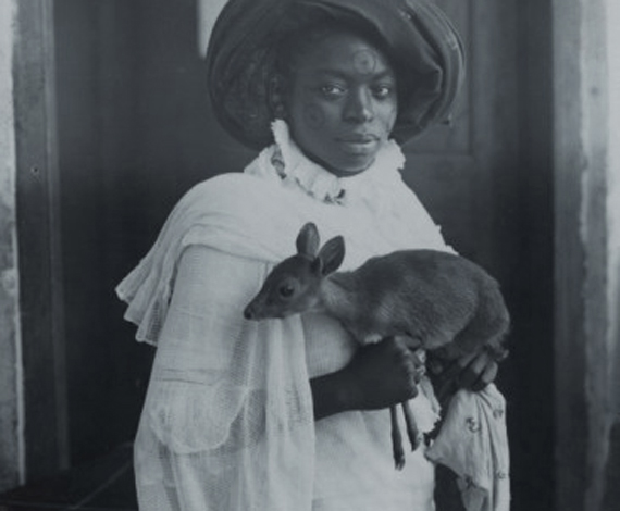 Young Kenyan Woman Holding a Pet Deer