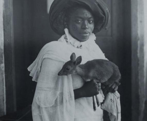 Young Kenyan Woman Holding a Pet Deer